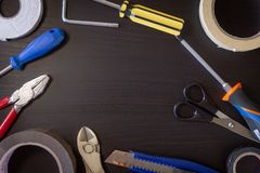 DIY Tools on Black Wooden Background stock images