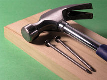 DIY, Tools for home improvement. Laying on top of board - Green background stock images