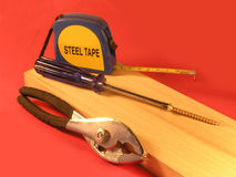 DIY, Tools for home improvement. Tools laying on top of fine cabinet lumber royalty free stock photo