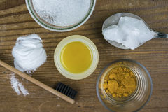 DIY toothpaste with ingredients. Coconut oil, turmeric, baking soda, Xylitol and bamboo toothbrush Stock Photo
