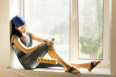 DIY woman taking a rest from decorating Royalty Free Stock Photo