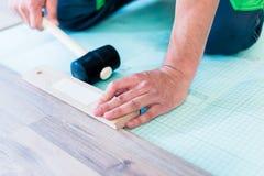 DIY workman flooring apartment floor Royalty Free Stock Photo