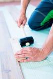 DIY workman flooring apartment floor Royalty Free Stock Images