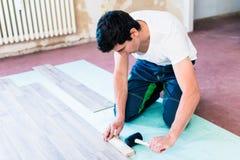 DIY workman flooring apartment floor Stock Photo