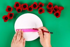 Diy wreath red poppy Anzac Day, Remembrance, Remember, Memorial day made of cardboard egg trays. 8 Diy wreath red poppy Anzac Day, Remembrance, Remember stock photo