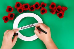 Diy wreath red poppy Anzac Day, Remembrance, Remember, Memorial day made of cardboard egg trays. 10 Diy wreath red poppy Anzac Day, Remembrance, Remember stock image