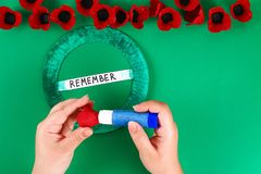 Diy wreath red poppy Anzac Day, Remembrance, Remember, Memorial day made of cardboard egg trays. 12 Diy wreath red poppy Anzac Day, Remembrance, Remember stock image