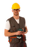 Diy - young cheerful man holding battery screwdriver isolated ov Royalty Free Stock Photos