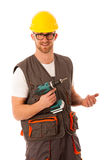 Diy - young cheerful man holding battery screwdriver isolated ov Stock Photo