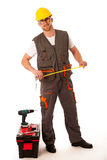 DIY - young man measuring with meter  equiped with toolkit and b. Atery drill isolated over white Stock Images