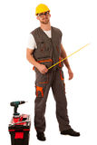 DIY - young man measuring with meter  equiped with toolkit and b Stock Photos