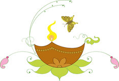 Diya & Butterfly Ornmental. Diya (oil Lamp) attracting a Beautiful Butterfly Royalty Free Stock Photography