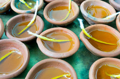 Diya clay lamps filled with oil and a cotton wick Stock Images