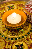 Diya lamp on a decorated golden plate Stock Photo
