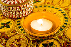 Diya lamp on a decorated golden plate Stock Images