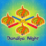 Diya lamp and stick for Dandiya night Royalty Free Stock Photo