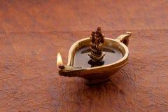 Diya med gudinnan Lakshmi royaltyfria bilder