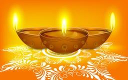 Diya på Rangoli för Diwali Arkivbilder