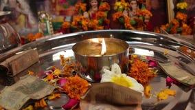 Diya in thali for praying stock video footage