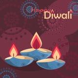Diya trois brûlant sur le fond de vacances de Diwali Images stock