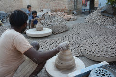 Diyas fail to light up potters` lives. The making of traditional earthen pots is almost an extinct practice in the country. Only a few pockets in the country Stock Image