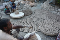 Diyas fail to light up potters` lives. The making of traditional earthen pots is almost an extinct practice in the country. Only a few pockets in the country Royalty Free Stock Image
