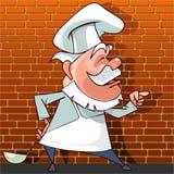 Diz o cozinheiro dos desenhos animados com uma concha à disposição Imagens de Stock