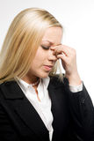 Dizziness. Business woman suffers from a headache on a white background Stock Images