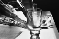 Dizzy. Glass and cell phone on the table - photo taken  by zooming method Stock Photography