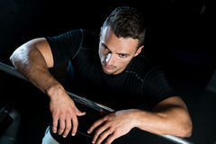 Dizzy In The Gym. Young Muscular Caucasian Man Resting At The Gym Stock Images