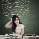 Dizzy student preparing for exam Royalty Free Stock Photo