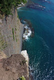 Dizzying view from the high cliffs down to sea Royalty Free Stock Image