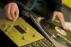 DJ. A DJ with a turntable and a mixer royalty free stock photo