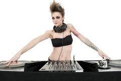 穿在白色背景的美丽的年轻女性DJ画象无背带的女用贴身内衣裤 库存照片