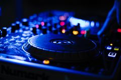 DJ in Action Playing Music. Shot by M.D.P DJ in Action Playing popping beats and having a great time royalty free stock image