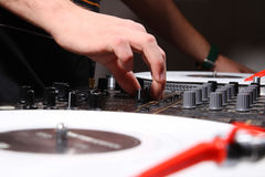 DJ adjusting soiund level on mixing controller Stock Images