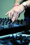 DJ adjusting sound level on mixer Stock Photo
