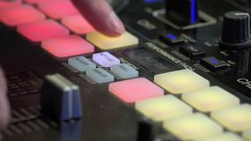 DJ beat maker pushing colourful buttons on the beat pad. Close up of mans fingers pressing.  stock video