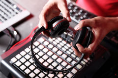 DJ beats with black plate. Hands DJ mixing music at the club during the event royalty free stock images