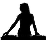 DJ. Beautiful male DJ with her headphones is standing at her deck mixing sound Royalty Free Stock Photo