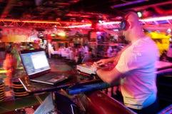 DJ behind the control panel Stock Photos
