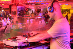 DJ behind the control panel Royalty Free Stock Photos