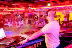 DJ behind the control panel Royalty Free Stock Image