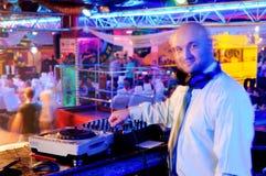 DJ behind the control panel Stock Photo