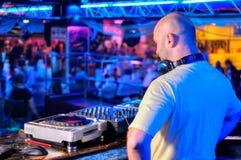 DJ behind the control panel Stock Image