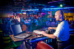 DJ behind the control panel Stock Images