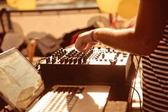 DJ behind remote control works adjust sound royalty free stock photos