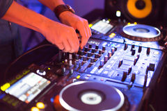 DJ behind the turntable stock photo