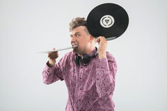 DJ biting vinyl record Stock Images