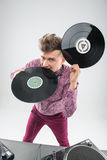 DJ biting vinyl record Royalty Free Stock Images